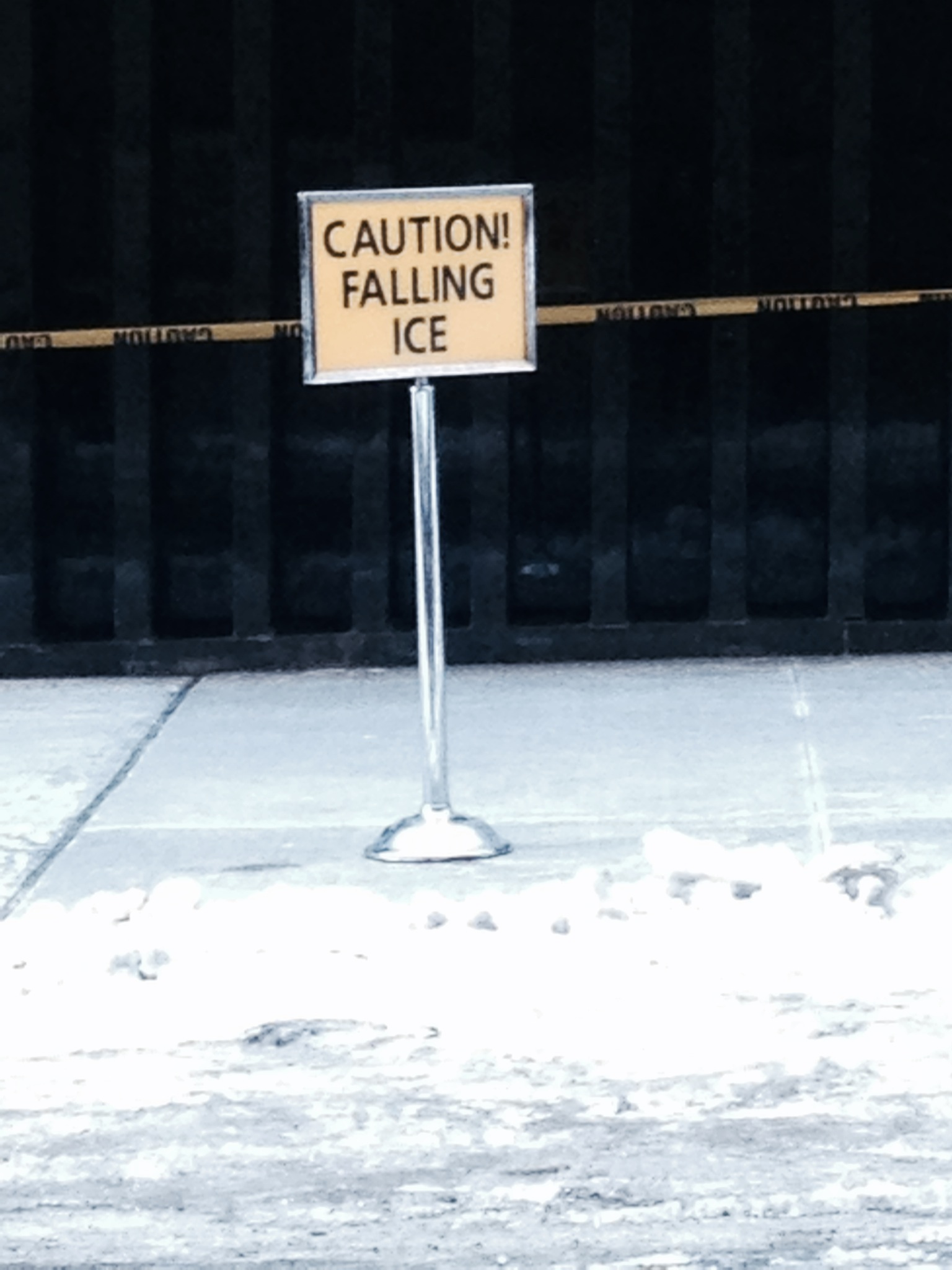 A sign in the Financial District warns pedestrians of falling ice. Photo by Lucy LeFever.