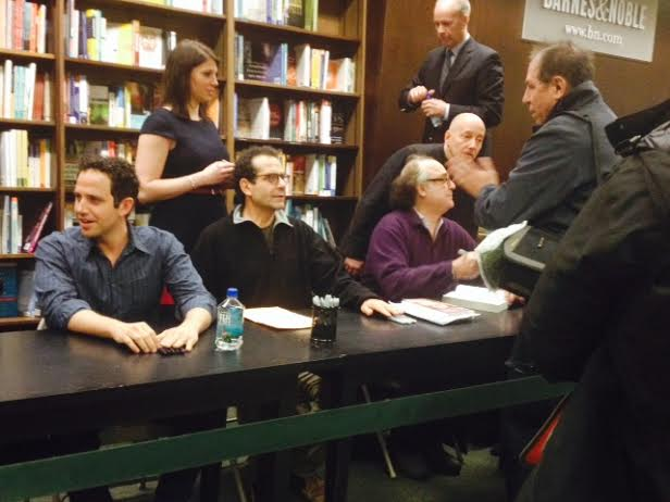 "Upcoming ""Act One"" leads Santino Fontana and Tony Shalhoub and Christopher Hart sign autographs of a new addition of the play's source material of the same name ""Act One"" by Moss Hart Hart at a NYC Barnes and Nobles on Feb. 18. Photo by Jennifer Verzuh."