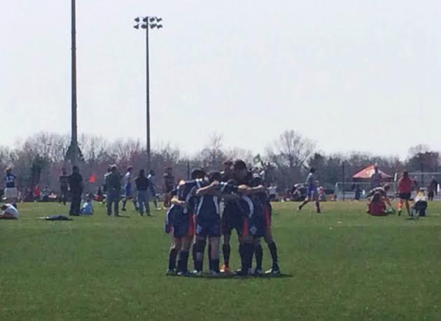 The starting seven pray before the first game. Photo by Brian Stewart.