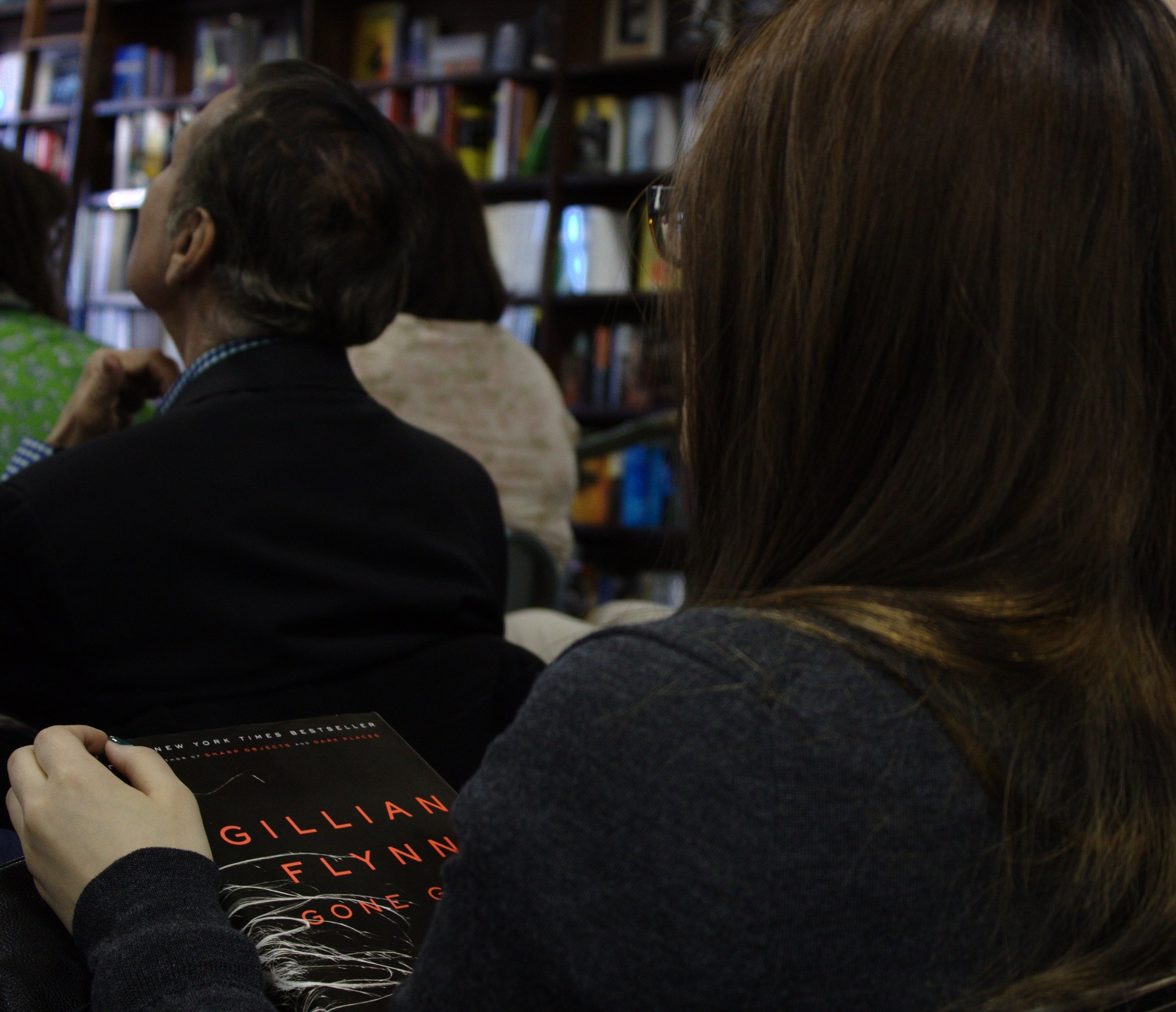 "A young woman holds her copy of Gillian Flynn's ""Gone Girl"" in the audience at an event on April 24 in New York City where Flynn discussed the book and her writings. Photo by Jennifer Verzuh."