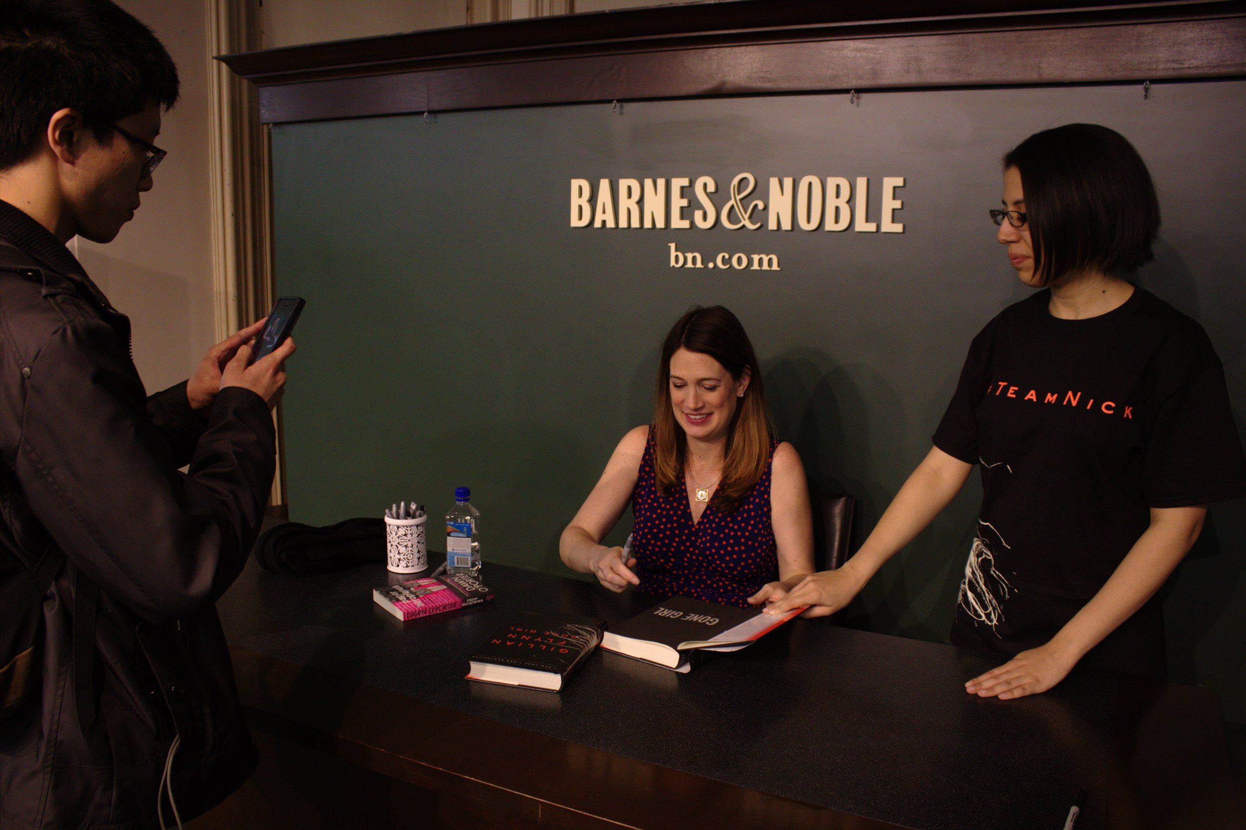 "Author Gillian Flynn signs copies of her books at Barnes and Nobles in New York City on April 24 following a discussion in honor of the paperback release of ""Gone Girl."" Photo by Jennifer Verzuh."