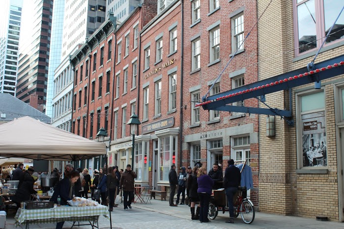 Tucked cozily behind the Seaport Museum, Cannon's Walk hosts a line of vendors eager to share their craft.