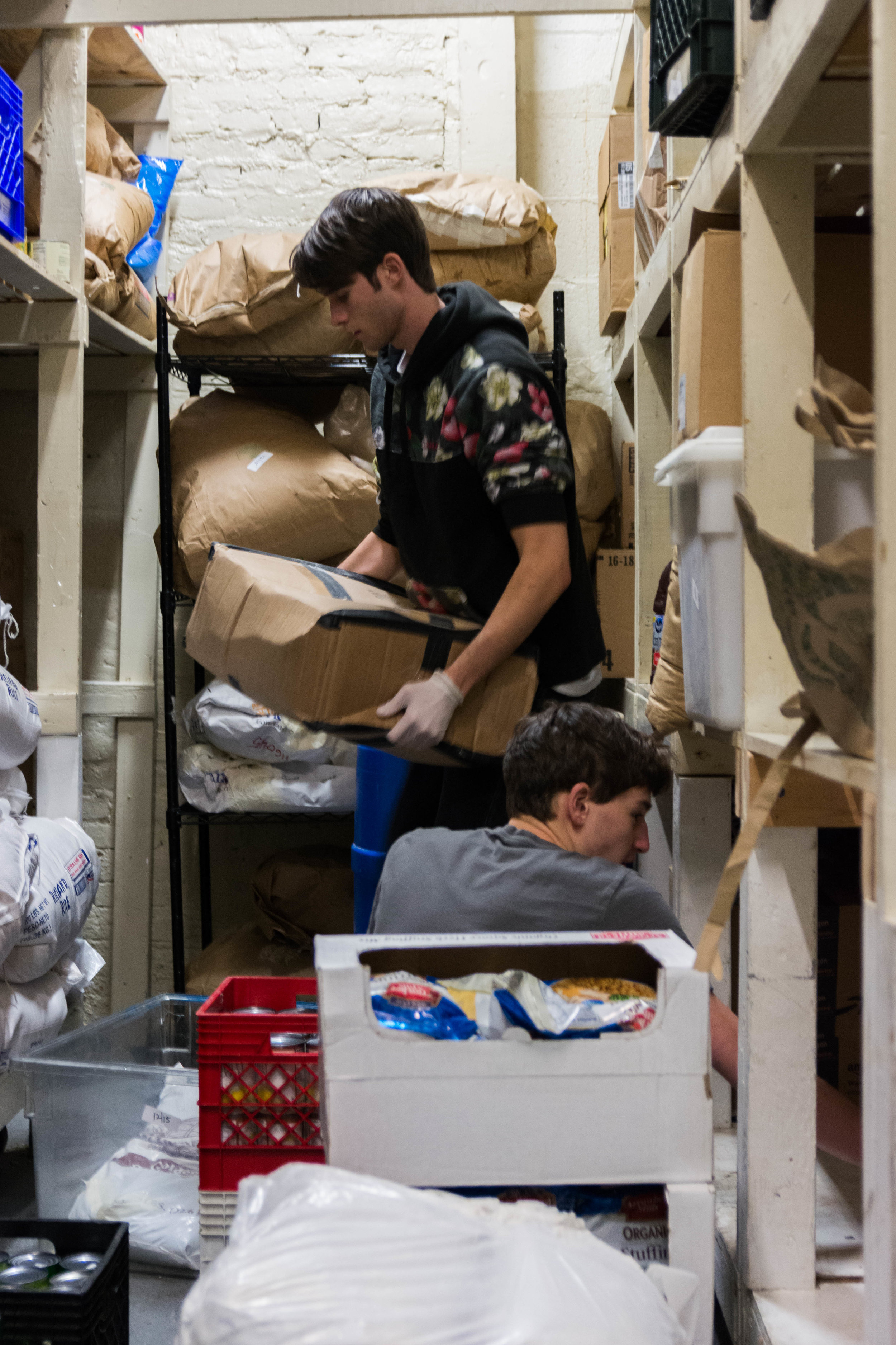 Zeke Ward ('19) and Andrew Welser ('19), organizing The Bowery Mission's food pantry. Photo by Sung Jun Kim.