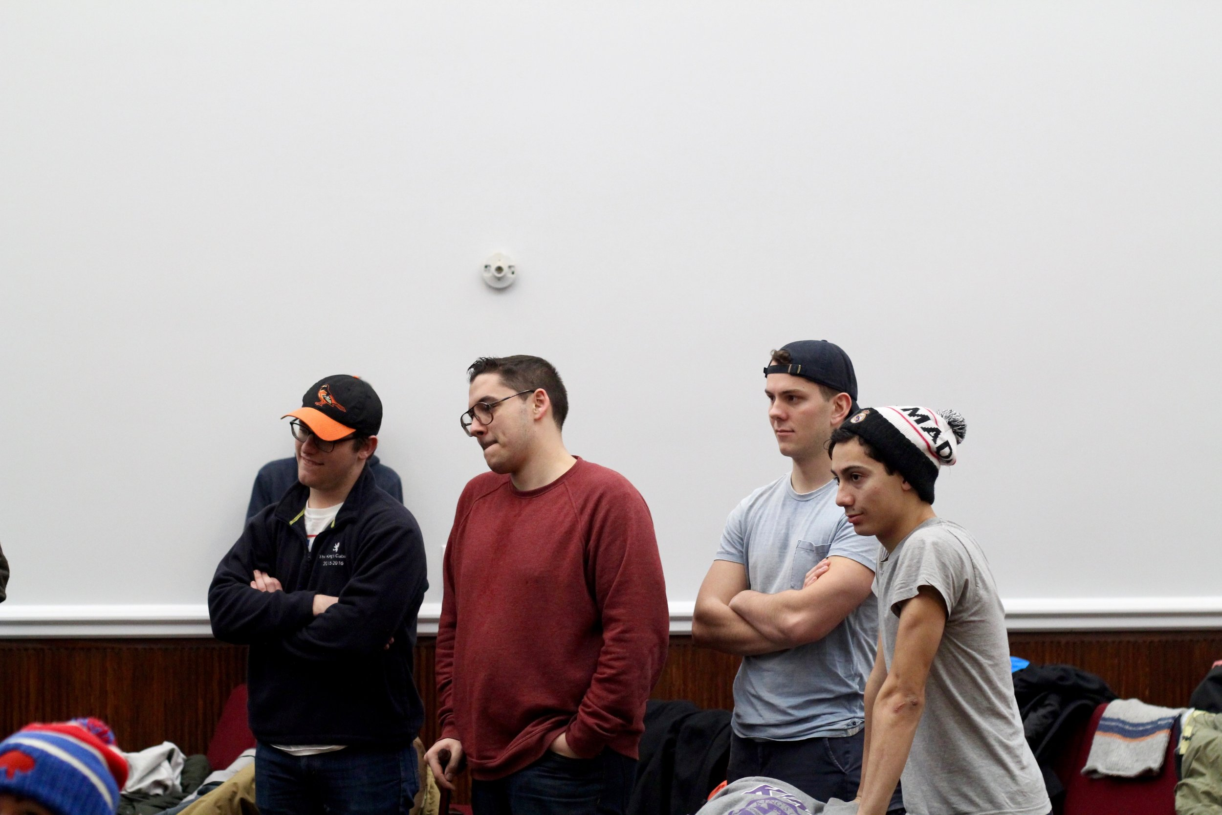 (From left to right) Reese Evans ('16), Fisher Derderian ('16), Jesse Inman ('16) and Matt Contreras ('17) listening to instructions at Manor Community Church. Photo by Taylor Thompson.