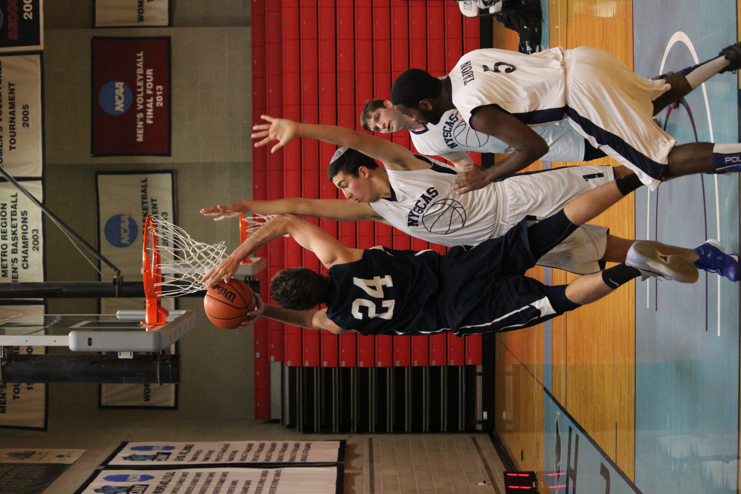 Forward #24 James Brooks ('17) goes up against NYSCAS (Photo Credit: Michael Sheetz)