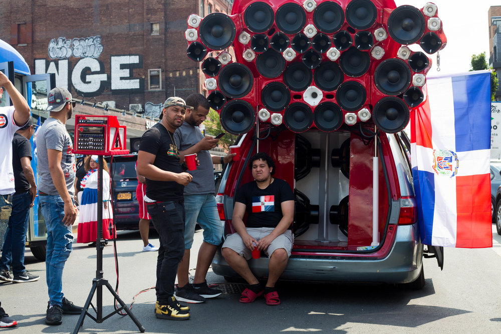 A souped up speaker system on the back of a Honda Odyssey, capable of providing thousands of watts of bass. At the 18th annual Williamsburg Dominican Parade, on Sunday, Aug 26, in New York. Photo: Wes Parnell