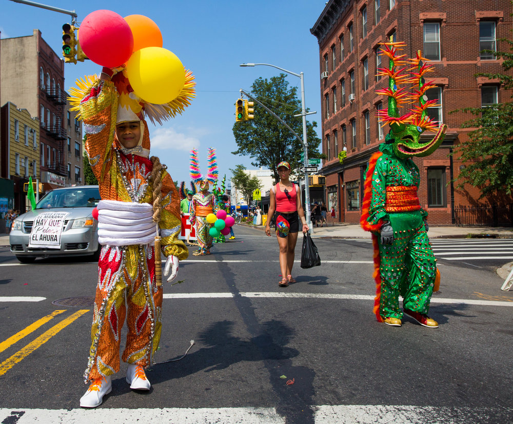 Young and older boys dressed in Carnival costumes and wielding boar whips at the 18th annual Williamsburg Dominican Parade, on Sunday, Aug 26, in New York. Photo: Wes Parnell