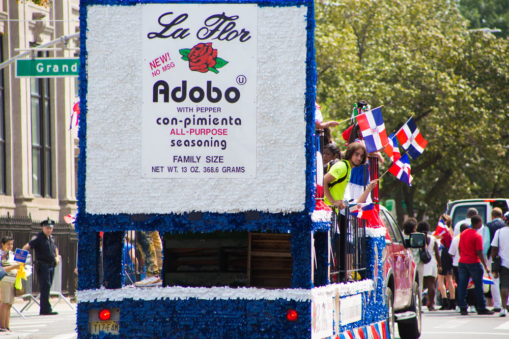 """THe """"La Flor"""" float passing Grand Ave. at the 18th annual Williamsburg Dominican Parade, on Sunday, Aug 26, in New York. Photo: Wes Parnell"""
