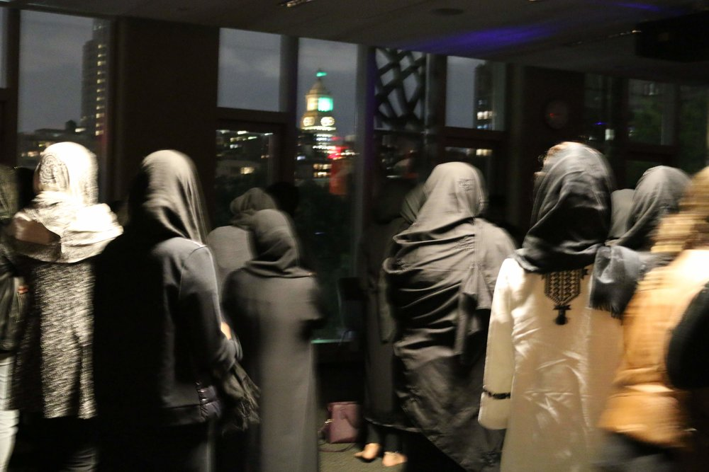 Women meet in a room to celebrate Ashura in New York City.    Photo credit to Maggie Ford