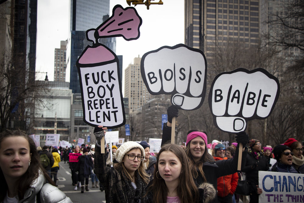 Girls carrying signs on 59th Street in NYC during the Women's March on Saturday, January 19, 2019. || Photo credit to Bernadette Berdychowski