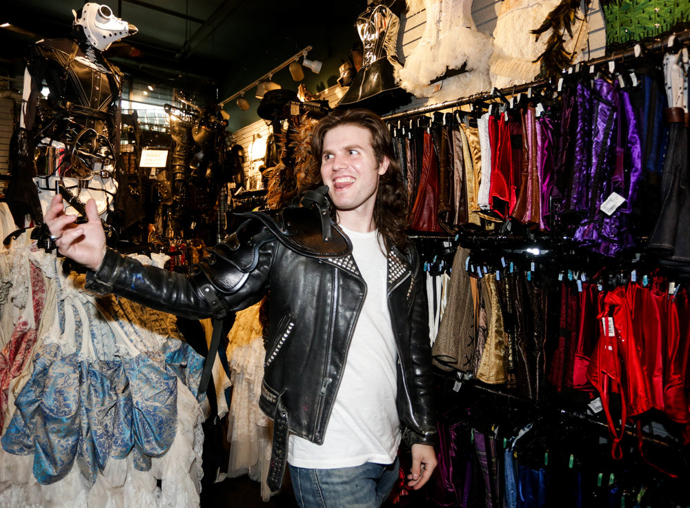 """Dylan Vandenhoeck prefers the armor, he said """"it would go well with my sword at home."""" In New York City at Goth Renaissance on Saturday, March 31, 2019. (Wes Parnell for EST)"""