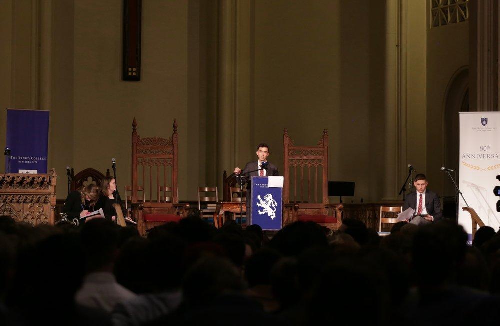 Kyle Kendrick debating for the house of C.S Lewis during the Final Debate.    Photo Credit to Gabriela Kressley