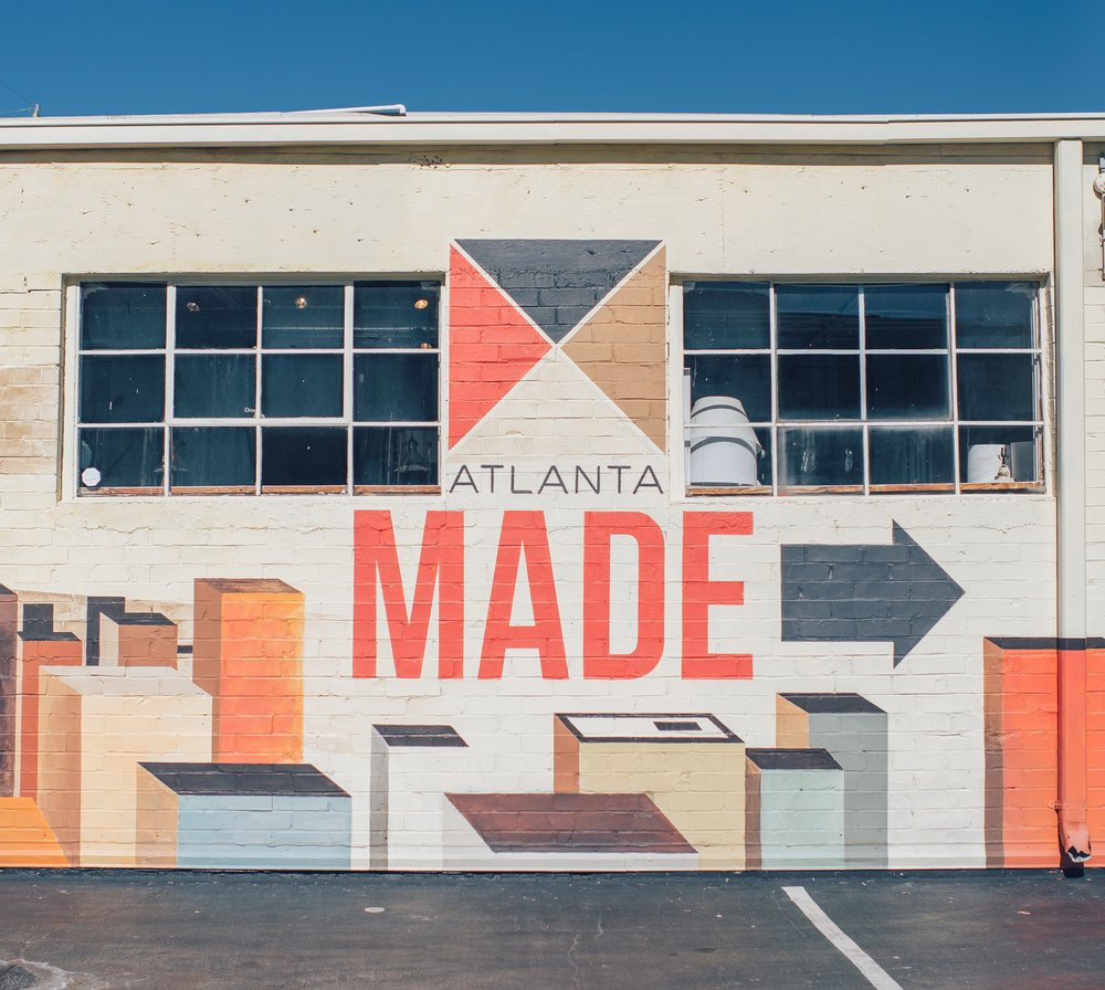 Side of building reading Atlanta Made with an arrow pointing to the right