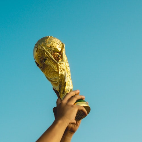 world cup trophy being held up