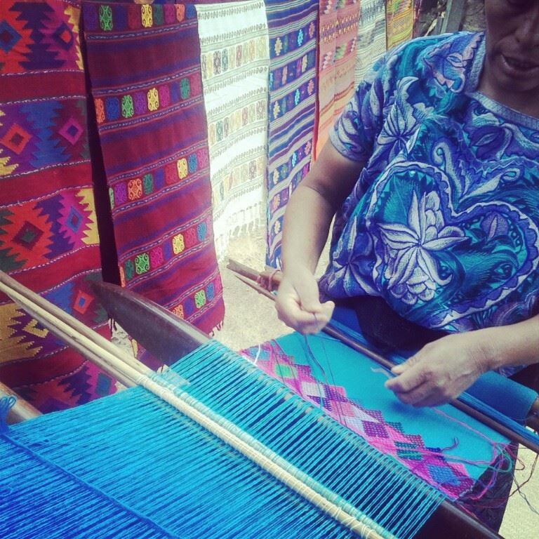 Weaver using backstrap loom. Chiapas, Mexico. Photo by Alyce Ornella