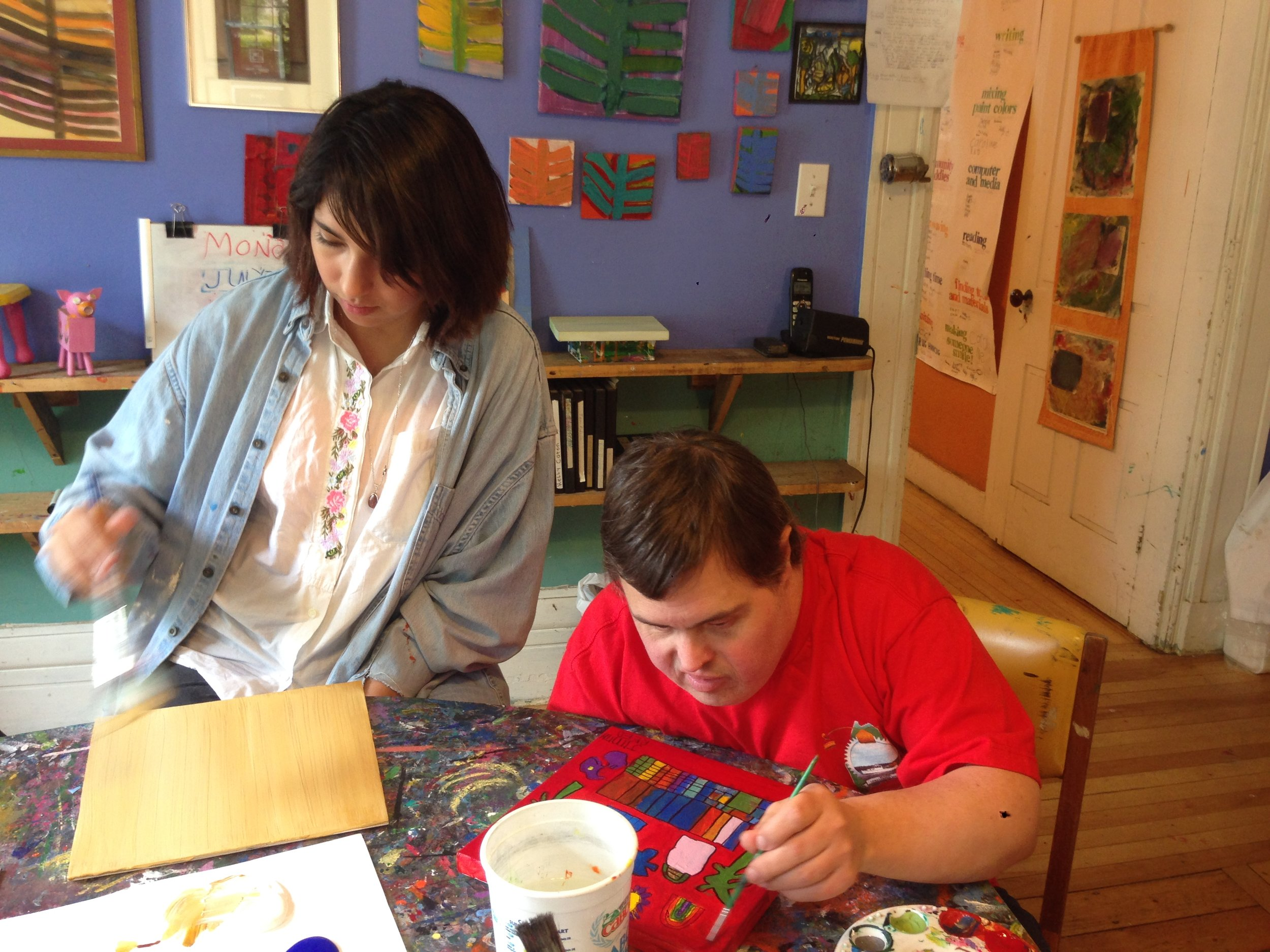 Celina and Jimmy work in the painting studio.