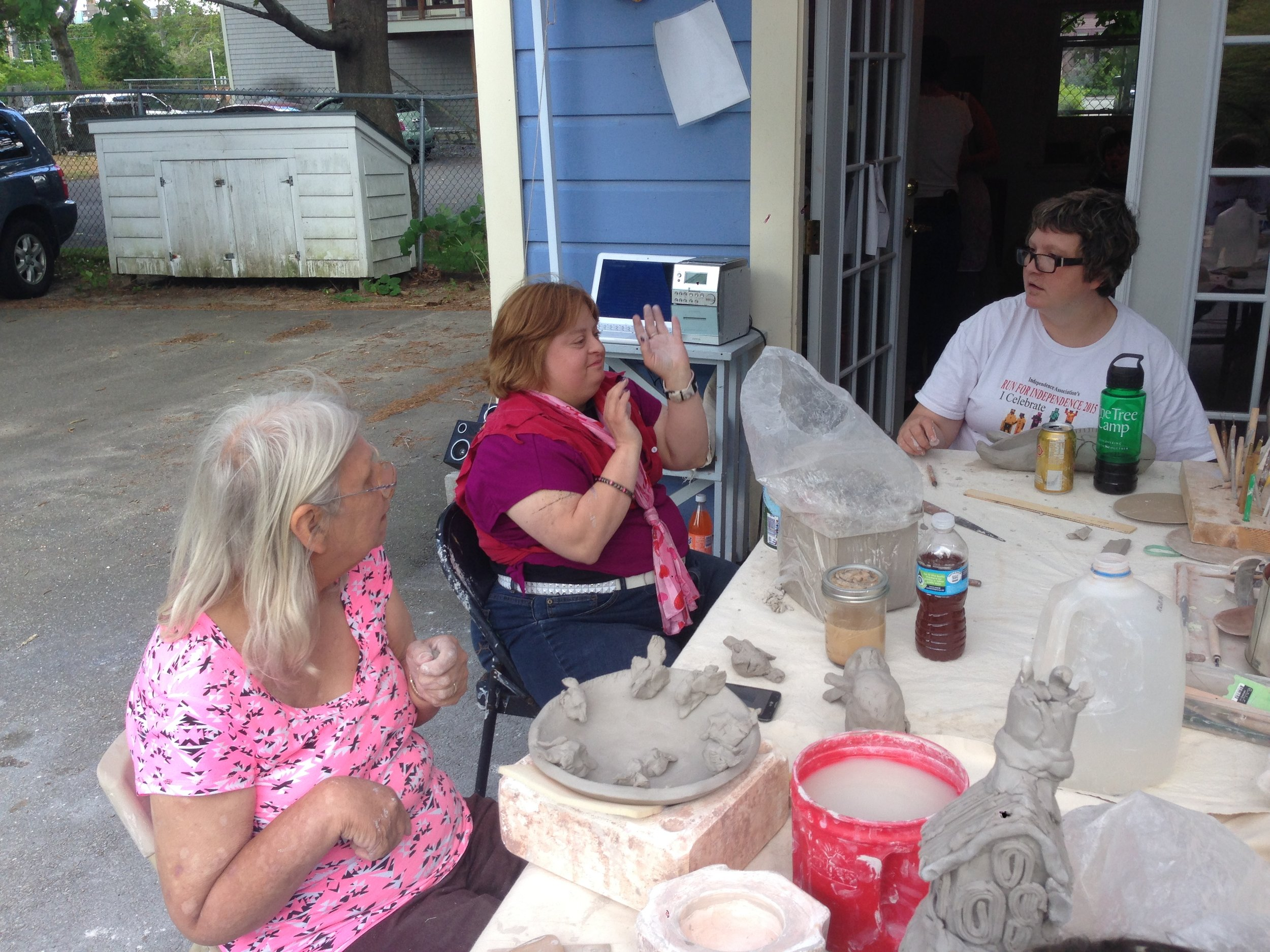 Diane, Kim D. and Kelly enjoying work in the clay studio!