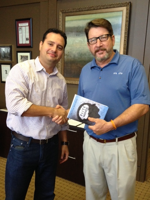 Carlos Giraldo recieves book from Tim Mc.9.10.14.jpg