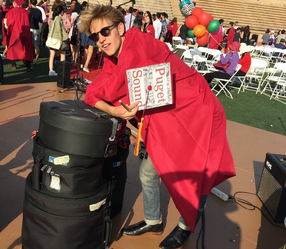 "After Alex Dyson went to the University of Puget Sound in Tacoma to study Economics, Amy had to find a new idea. Alex with his drum kit after the graduation at Torrey Pines High School, where he and his friends closed the ceremony with Curtis Mayfield's ""Move On Up."""