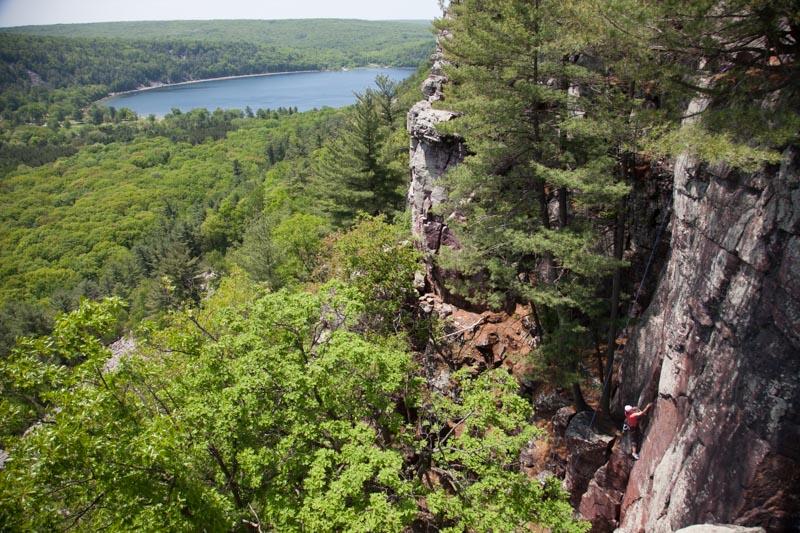 Unknown climber top-ropes Prime Rib (5.9+) at Devil's Lake State Park.