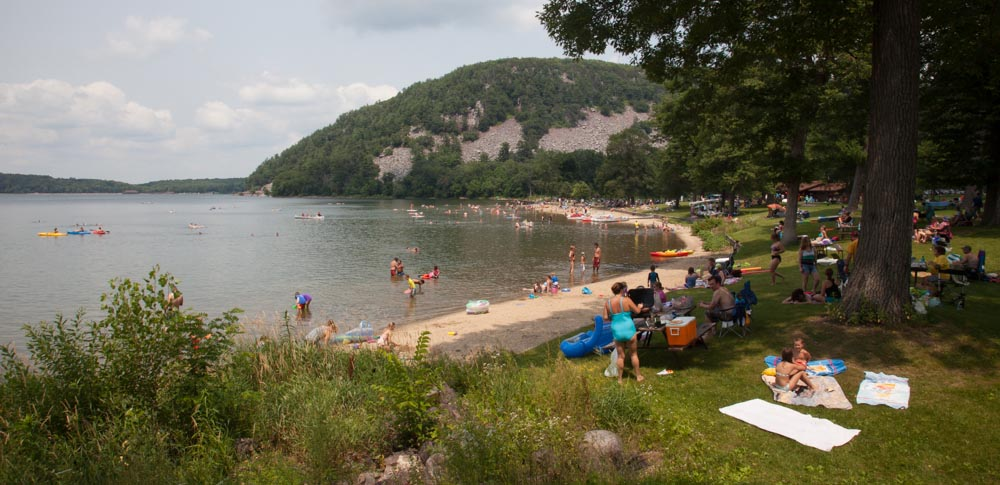 The wide arc of South Shore Beach at Devil's Lake.