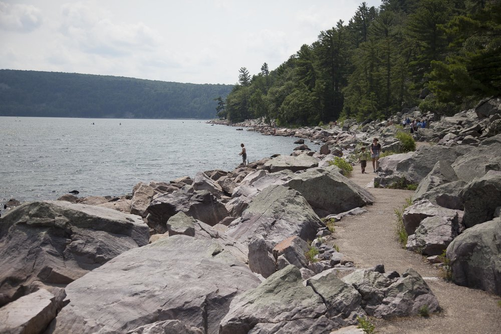 The Tumbled Rocks Trail is a popular, scenic, and easy hike from the North Shore of Devils Lake.