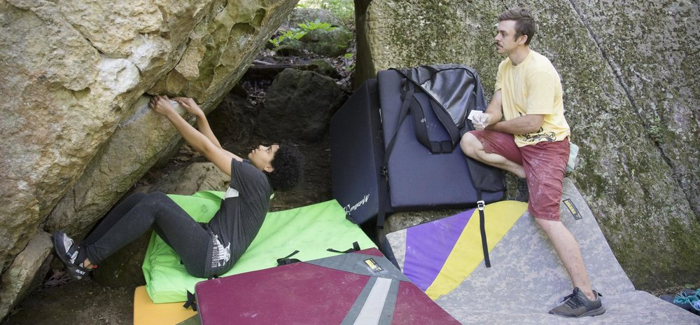 Instructor Kevin Baker watches a Boulders Youth Team member start Another Daydream (V3) in the Lonely Boulders area.