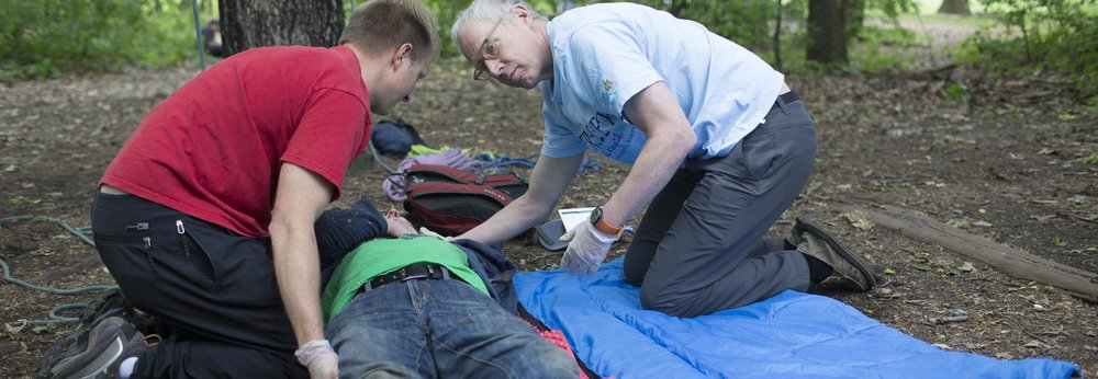 Two students care for a patient in a wilderness medicine drill at the MacKenzie Center during our 5-Day Wilderness First Responder course taught by  Wilderness Medical Associates .