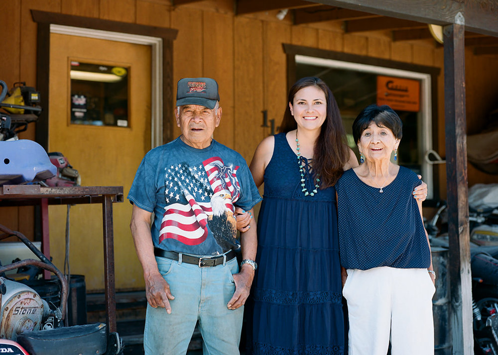 Affie with her parents, Jim & Lenore Burnside, at her dad's welding shop   in Jackson, Wyoming.