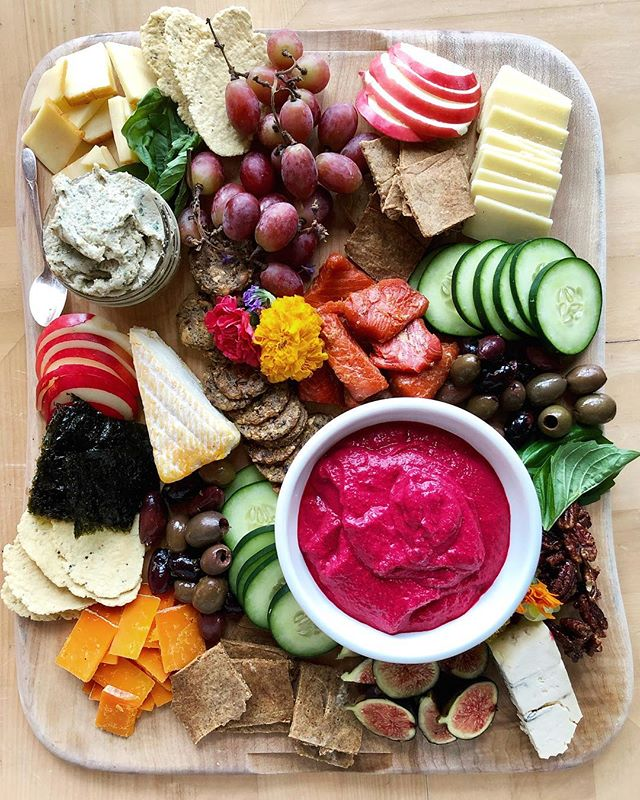Can we go back to the weekend, please?  My sister and I created this board of goodies to share with our friends for the perfect cabin lunch. What would you choose for your first bite?  Crackers: 1 cup wet almond pulp leftover from making milk* 3 tablespoons olive oil 1 tablespoon ground flax soaked in 2 Tbsp water  Bit of sea salt Herbs to season (I went a little over board on the cayenne in this batch. 🔥) Combine all ingredient in a bowl and stir to form a dough. I needed to add a bit of flour to help with the stickiness. Roll it out on parchment paper on a baking sheet so it's nice and thin. I covered the dough with another sheet of parchment to make this step a little easier. Use a knife to score the dough with squares. Bake at 350 for 20 mins. Check on them and then you'll need another 15 or so depending on how thin you rolled out the dough. *  I'm assuming you could also use a cup of any flour and just add more water until you get a dough. Baking isn't my forte, but I like to experiment!