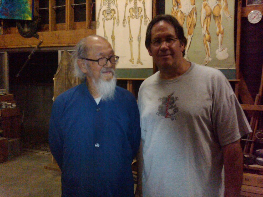 On the left in the blue shirt is Great Grand Master Jimmy Wing Woo with master Roy Abramowitz.