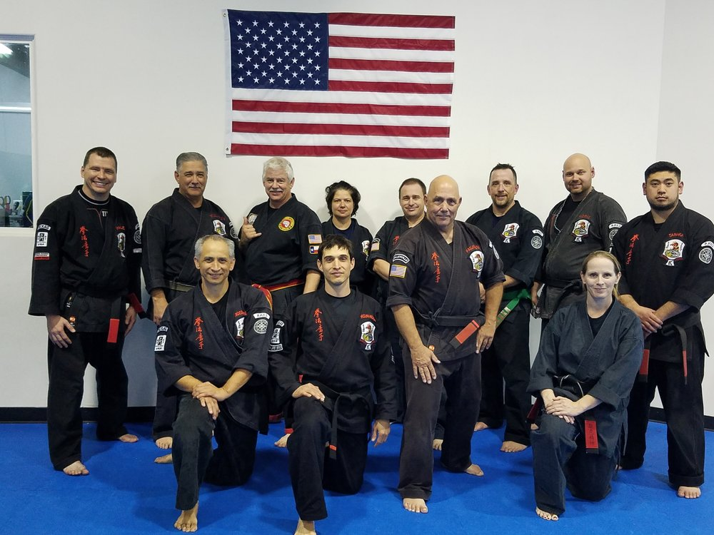 John Sepulveda group at Rob Hazelwood's (center-6th Dan) dojo in Colleyville GM Sepulveda next to GM Nick Chamberlain w shaka.jpg