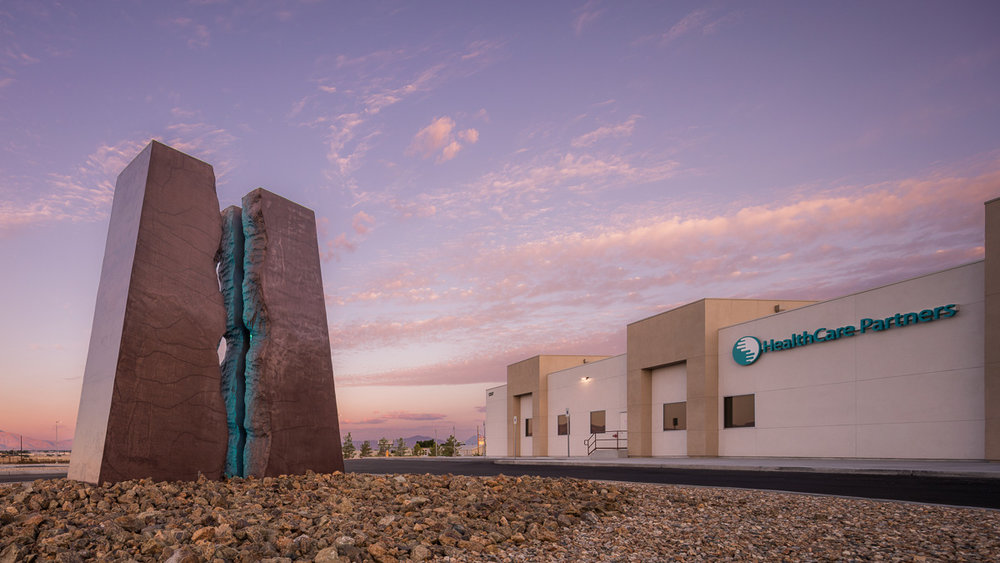 The new HealthCare Partners facility in Pahrump, NV features a rock sculpture with light display. Designed by Daniel Amster, Dakem & Associates, LLC.