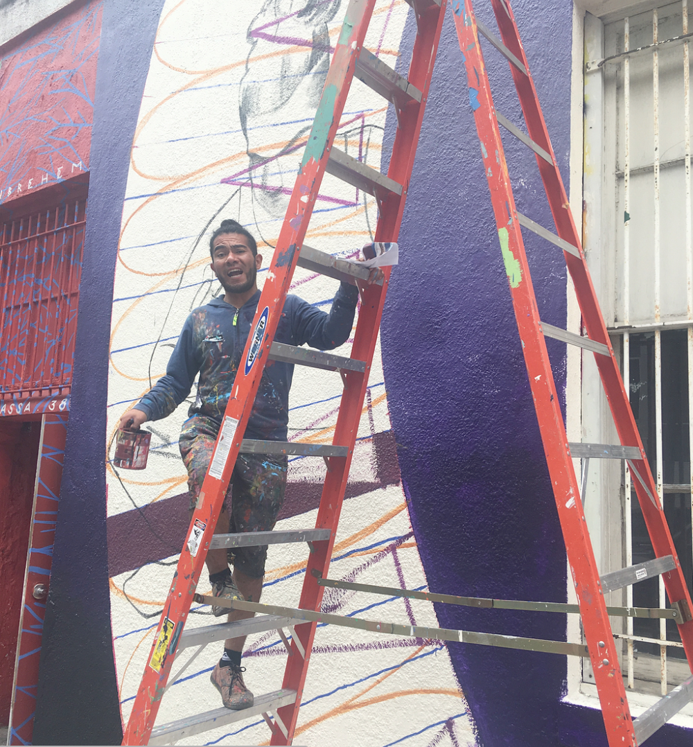 Cix Mugre Muralist in Process - Painting a Mural Downtown Austin