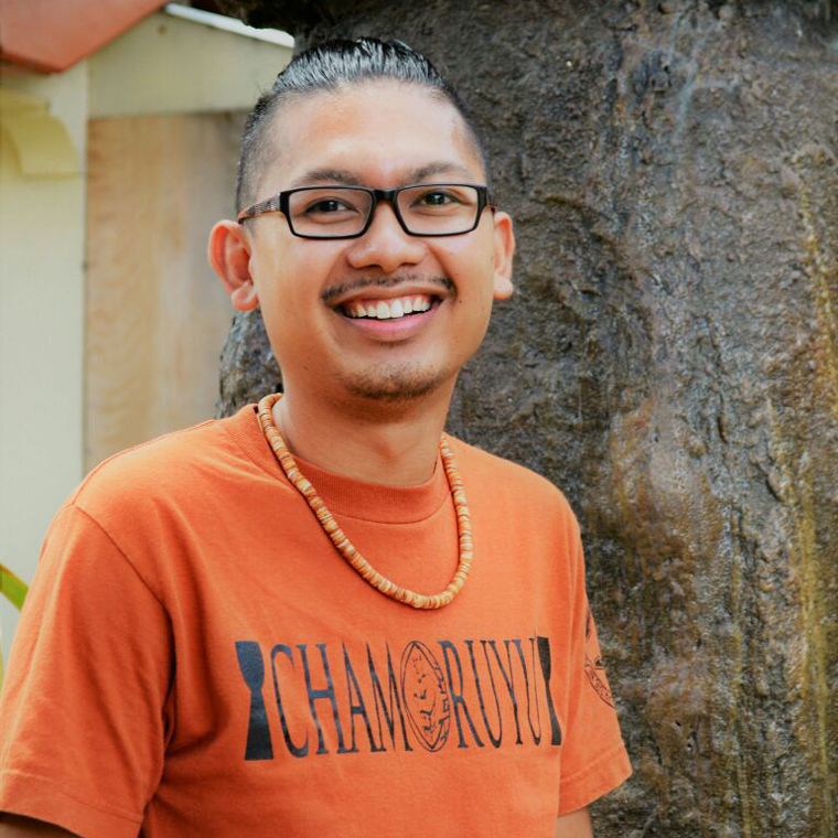 Sainan Ma'åse'  |  Frankie Casil II  Pineksai-Chamoru Immersion Educator,  Program Coordinator    Chamoru Studies Major, Techa, Photographer, Mt. Carmel Parish Youth Coordinator