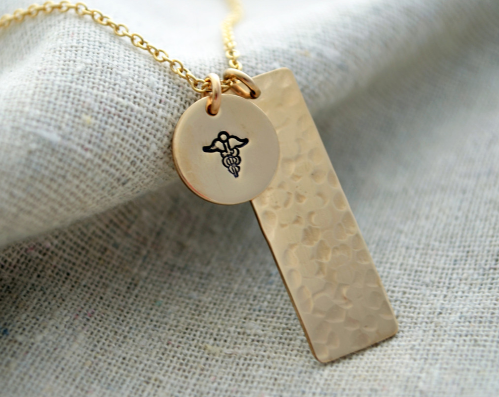 LONG TWO-SIDED GOLD MEDICAL ALERT NECKLACE    Melanie Marie is one of the many brands redefining medical bracelets.