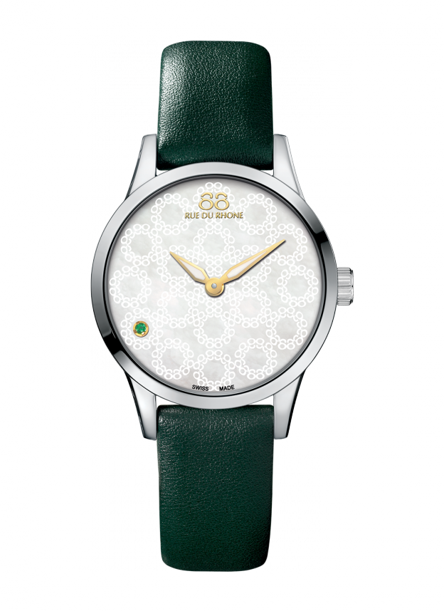 RIVE - 32 MM Quartz This timepiece looks sexy with any outfit! The intense mother–of-pearl dial and 88-lacework motif contrast with the dazzling green topaz index to create a unique lucky amulet.