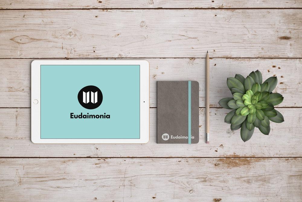 Eudaimonia Branding Mockup on Desk