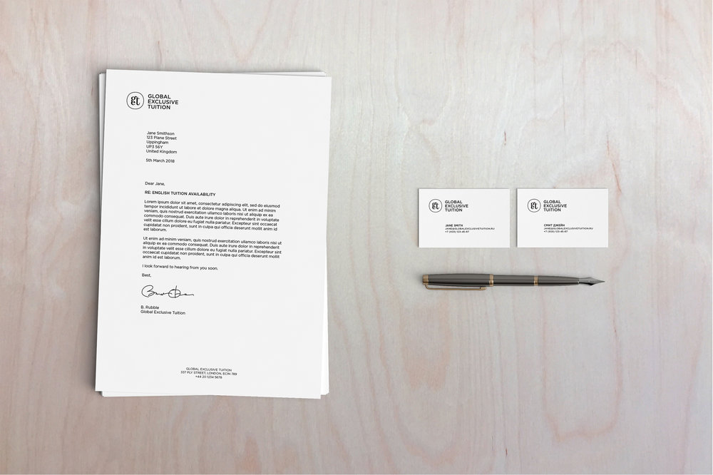 Global Exclusive Tuition logo and stationary on desk