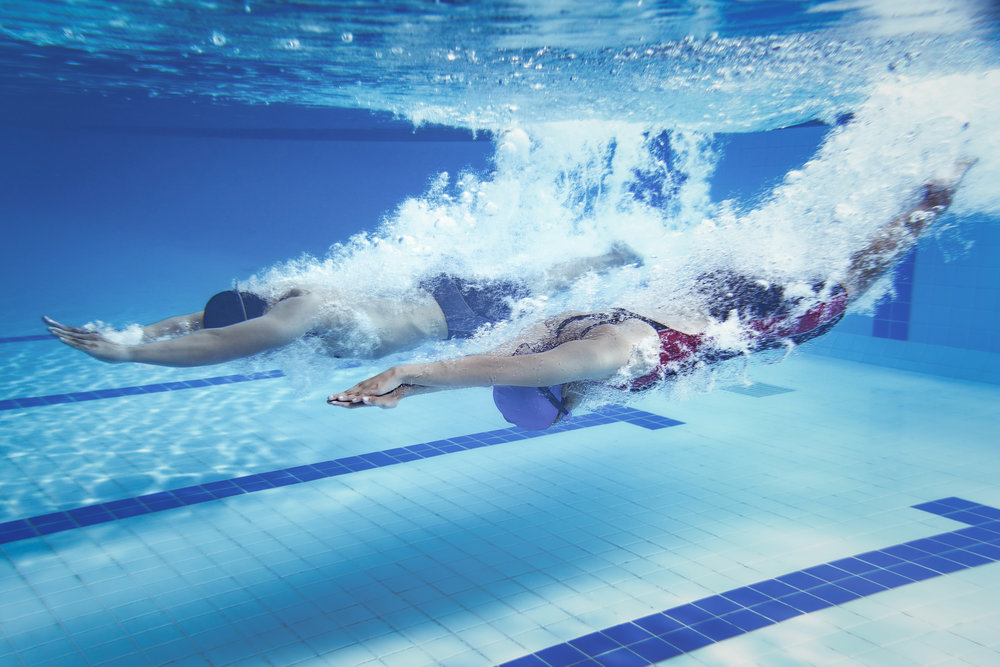 woman and man diving into swimming pool.jpg
