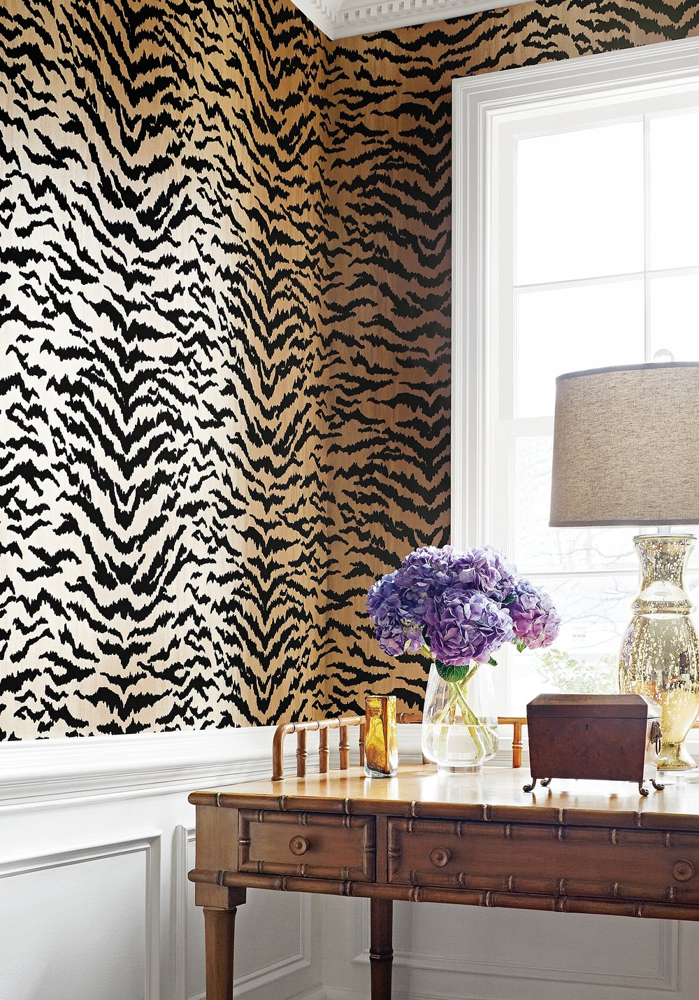 incorporating a print from one of our feline jungle friends brings bold and biting style to any space, while still soft and feminine.