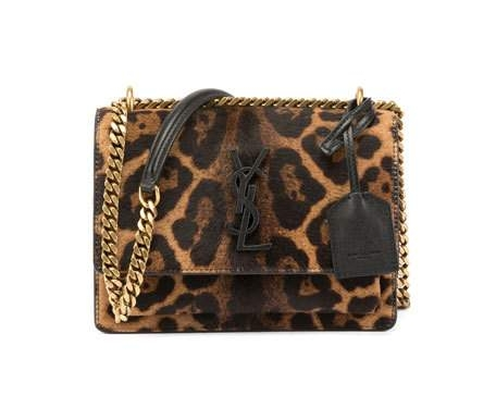 Saint Laurent Sunset Small Calf Hair Crossbody Bag  -- There's nothing tame about this leopard print calf hair crossbody! Whether styling with jeans and heels or an LBD, it definitely calls for a wild girls night out.