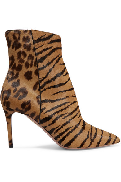 aquazzura alma pony-hair boots  -- What better way for Aquazzura to express its more-is-more approach than with animal print? Ticking off a major Fall '18 trend, these 'Alma' boots have been made in Italy from smooth pony hair that's boldly patterned with tiger stripes and leopard spots.