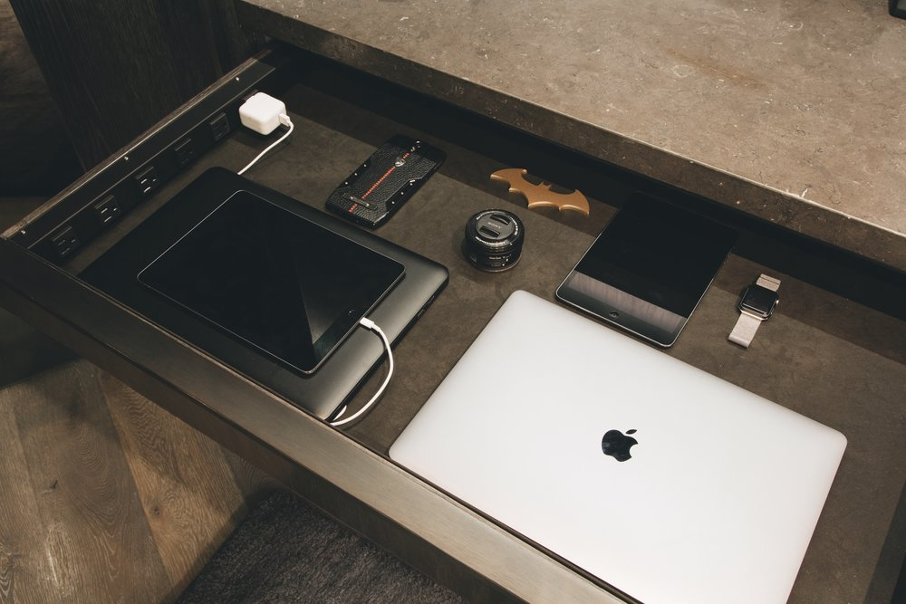 keep your devices tucked away and fully charged at all times, by installing an insert with an electrical outlet! This is a necessity for any busy professional, and helps you to disconnect when all your devices are in a drawer for the night.