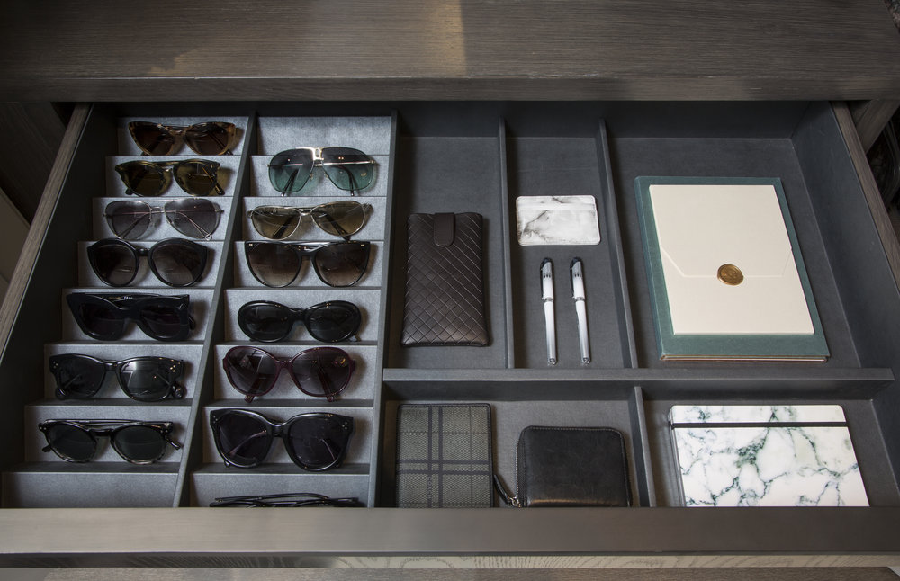 keep a drawer of daily essentials in a closet or piece of furniture near your front door! here, you can keep extra pens, sunnies, paper, and more for easy access at a momen't's notice on your way out the door.