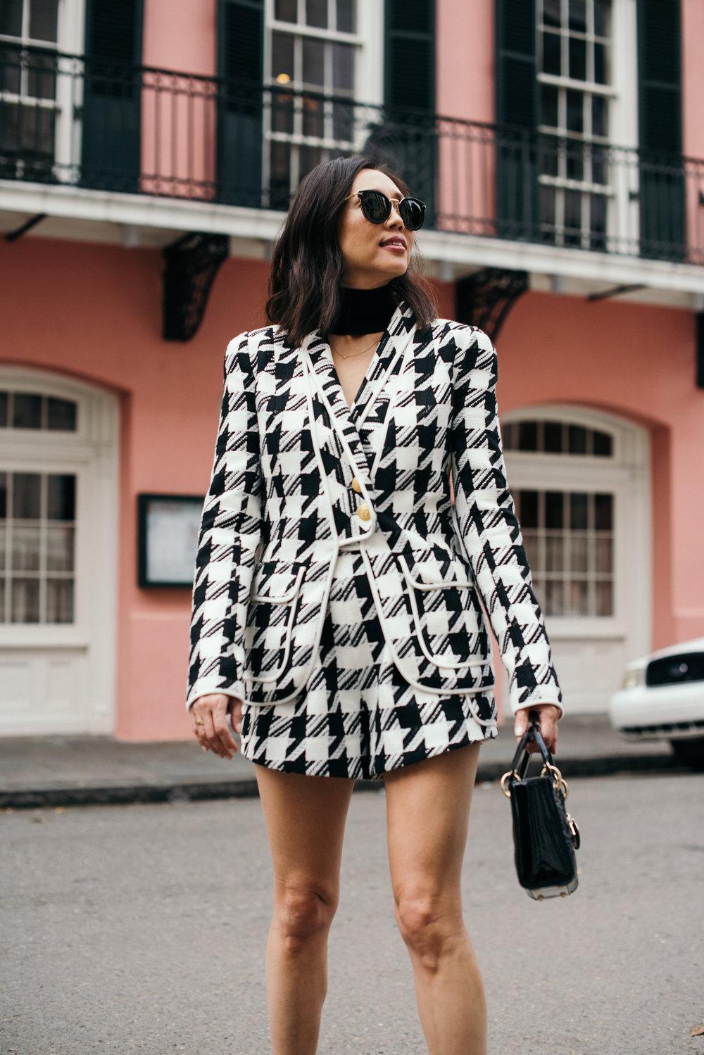 Shorts + blazer: balmain, bag: dior, boots: gucci, top: cushnie