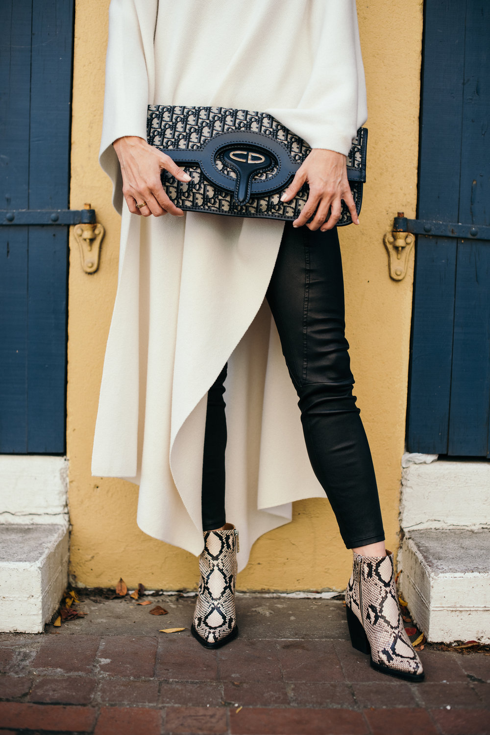 poncho: chloe, bag: dior, boots: chloe, pants: helmut lang