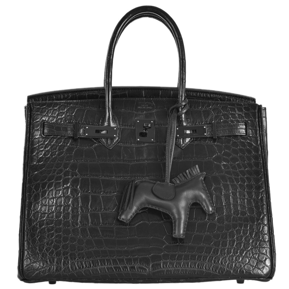 "the ""so black"" birkin just goes to show this trend is being carried through every part of the design world! from fashion to home furnishings, it's a clean, understated option that works with any style of home."
