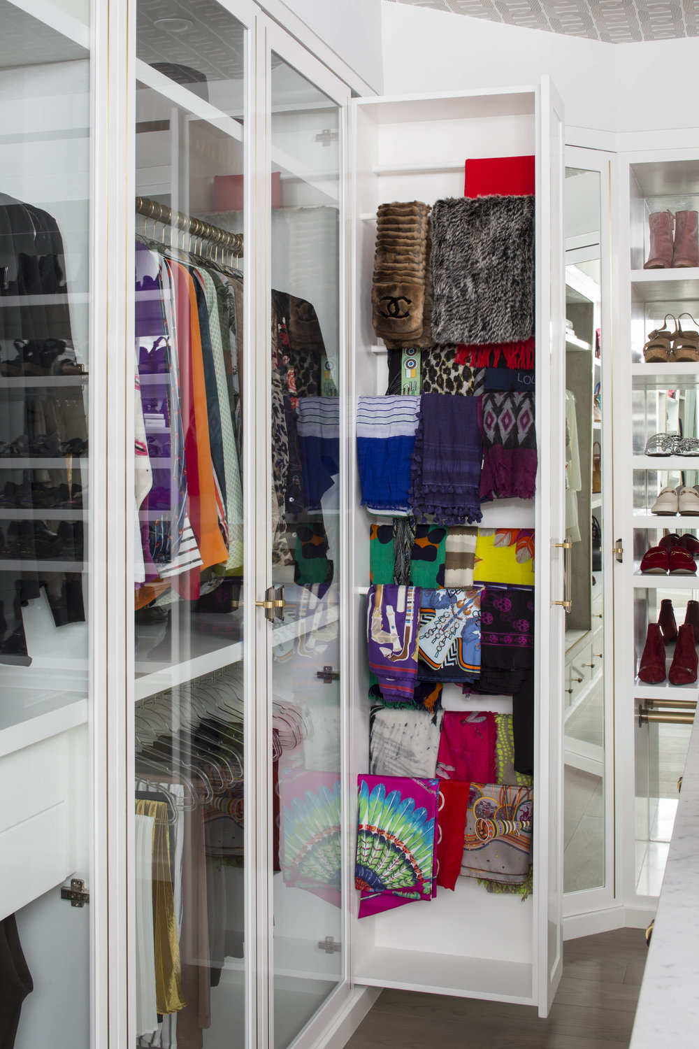 A HIDDEN SCARF CABINET KEEPS A COLORFUL COLLECTION TIDILY TUCKED AWAY.