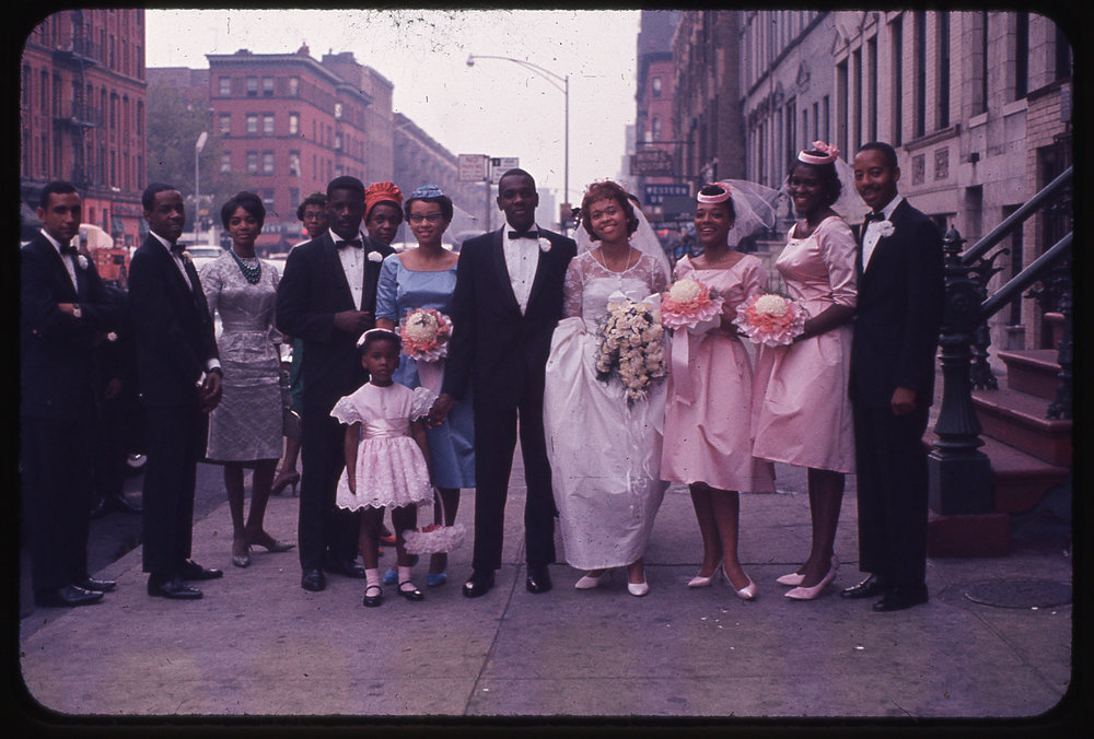 Thomas Allen Harris' parents wedding party on Lenox Avenue, Harlem, USA. Photograph taken by his grandfather Albert Sidney Johnson, c. September 1961